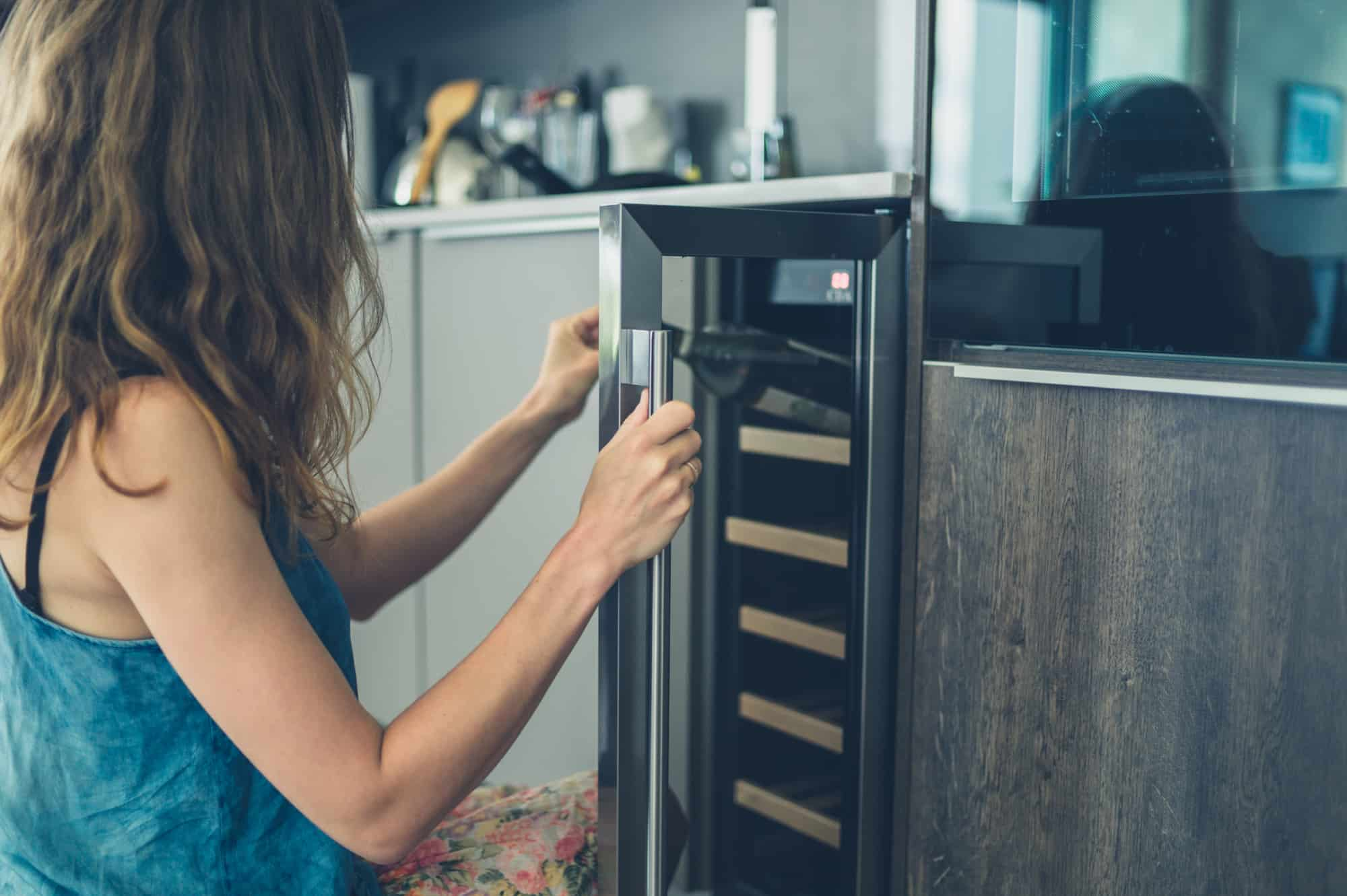 Woman Getting Bottle Of Wine From Cooler ⋆ C Amp W Appliance