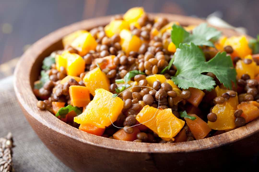 Lentil With Carrot And Pumpkin Ragout In A Wooden Bowl
